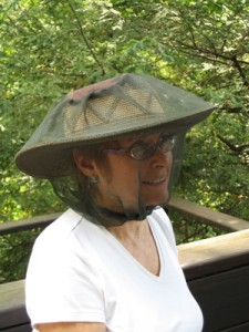 My neighbor, Alice, modeling my hat rigged to keep bugs at bay.  Thanks, Alice!